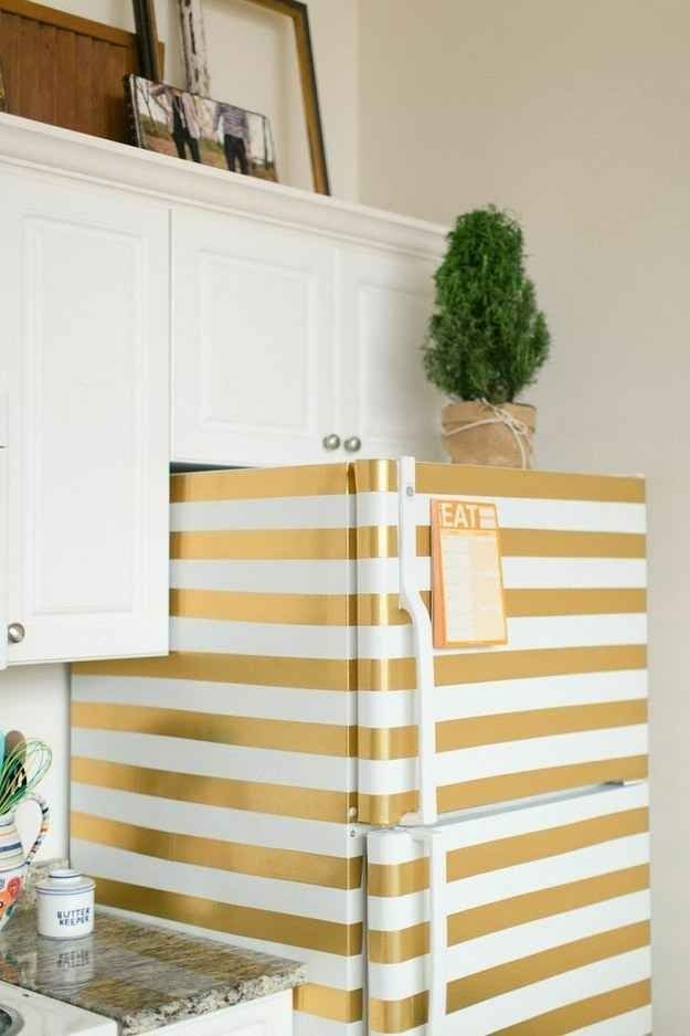 Tape up that boring white fridge and paint it gold.