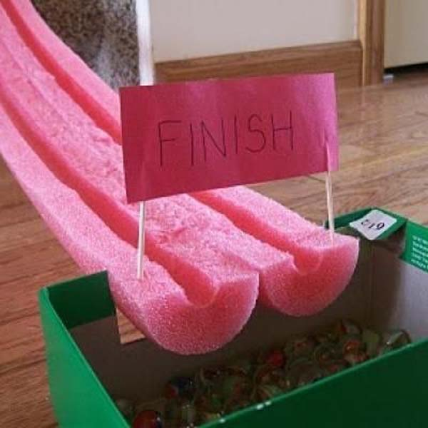 32.) Cut a pool noodle in half to make a marble race track.