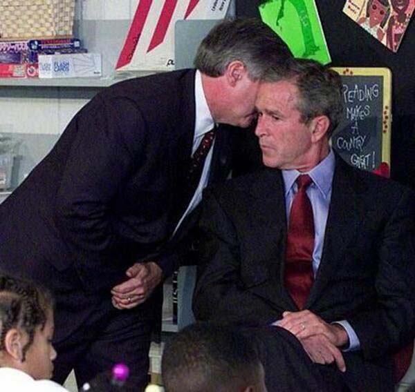 39.) President Bush receiving the news of the terrorist attacks on September 11th (2001).