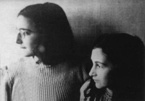 11.) This is supposedly the last photo of Anne Frank. She stands with her sister Margot in early-to-mid 1942. This was taken before her family were discovered and arrested on August 4th, 1944.