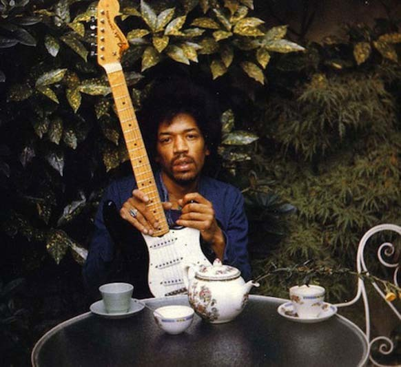 """17.) Jimi Hendrix poses with his favorite instrument, """"Black Betty,"""" the day before he died."""