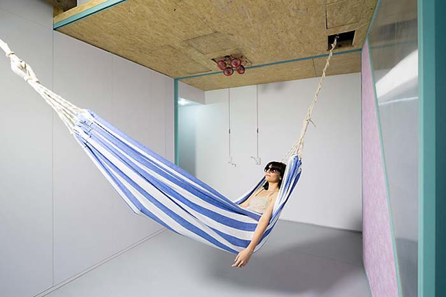 Also concealed in the ceiling is a hammock for maximum relaxing.